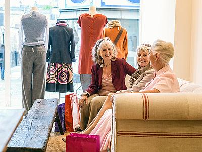 Senior women taking a break in boutique - p429m895366f by Colin Hawkins