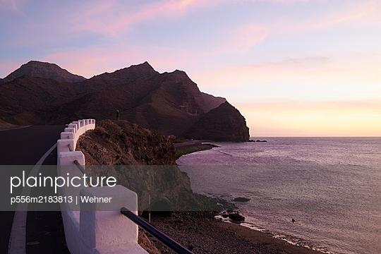 Coast road at sunset, Puerto de la Aldea, Gran Canaria - p556m2183813 by Wehner
