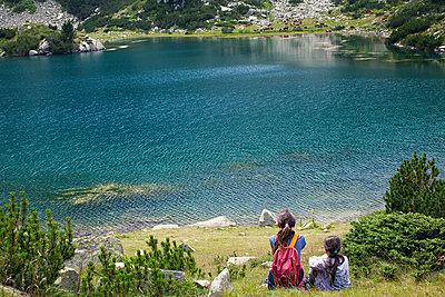 Bulgaria, Two girls at the mountain lake - p1432m2283927 by Svetlana Bekyarova