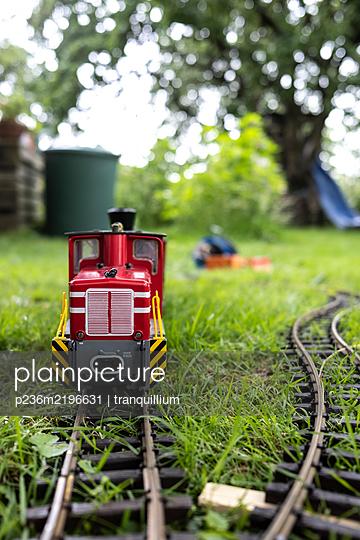 Toy train in the garden - p236m2196631 by tranquillium