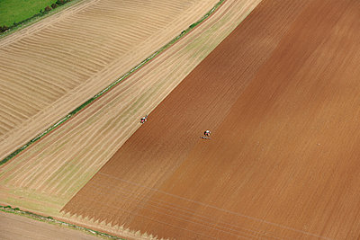 Ploughing field aerial view - p1048m1069225 by Mark Wagner