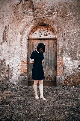 Woman in black dress - p1521m2272081 by Charlotte Zobel