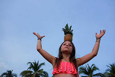 Girl With Pineapple - p1636m2216348 by Raina Anderson