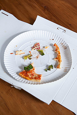 Pizza crusts on a paper plate in a cardboard box - p30120310f by Halfdark
