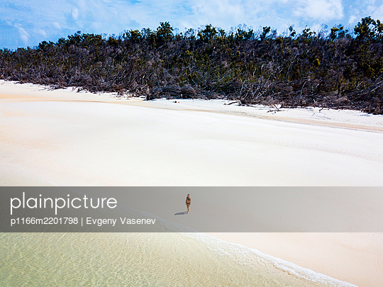 A woman is enjoying a beautiful Australian beach by herself - p1166m2201798 by Evgeny Vasenev