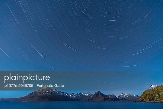 United Kingdom, Scotland, Inner Hebrides, Great Britain, British Isles, Isle of Skye, Star Trail above the Cuillin Hills, from Elgol Beach - p1377m2048705 by Fortunato Gatto