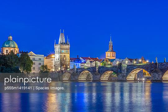 Charles Bridge and city illuminated at dusk, Prague, Czech Republic