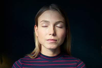 Young woman with closed eyes - p1124m1589202 by Willing-Holtz