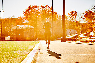 Female Athlete Running In Park In Boston - p343m1415987 by Josh Campbell