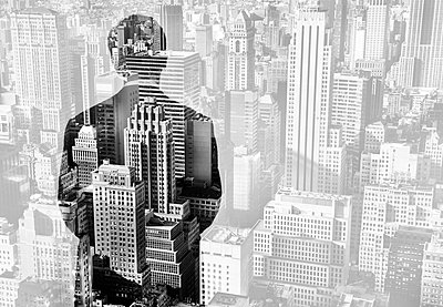 High angle view of cityscape of Manhattan, New York, USA, rear view of man wearing suit reflected in window. - p1100m1570979 by Mint Images