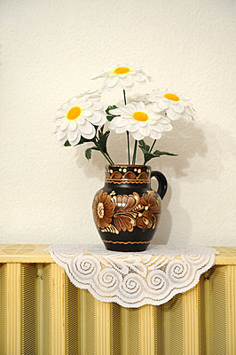 Vase with artificial flowers - p4902342 by Andreas Rumpf