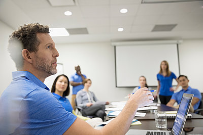 Male physiotherapist leading training in conference room meeting - p1192m1447338 by Hero Images