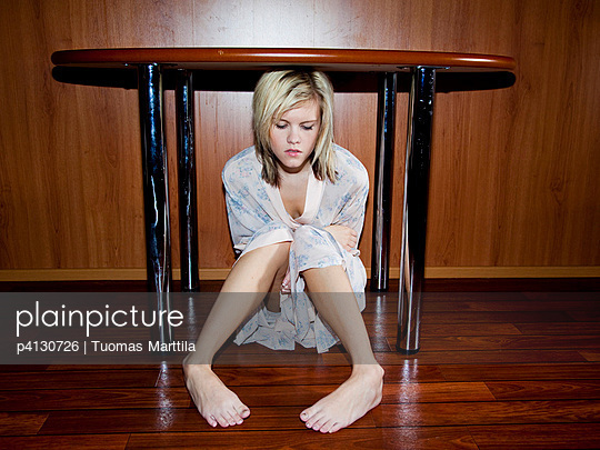 Woman under a desk - p4130726 by Tuomas Marttila