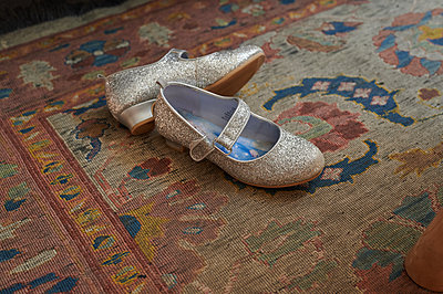 Shoes on a carpet - p1640m2242141 by Holly & John