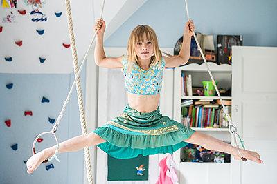 Girl doing splits while hanging - p312m1407621 by Fredrik Schlyter