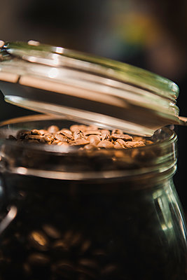 Coffee beans in preserving jar - p1150m2071181 by Elise Ortiou Campion