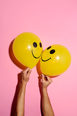 Two yellow balloons with Smiley faces - p1423m1537925 by JUAN MOYANO