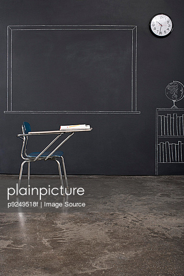A desk in a classroom - p9249518f by Image Source
