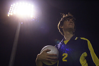 Soccer Player Holding Ball - p3070586f by Score. by Aflo