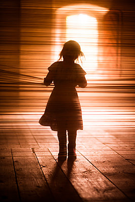 Silhouette of girl walking - p312m1229090 by Peter Rutherhagen