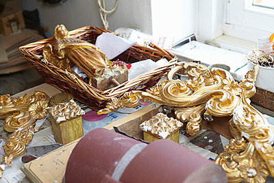 Gold embellishments on work table - p429m747170f by Stefano Gilera