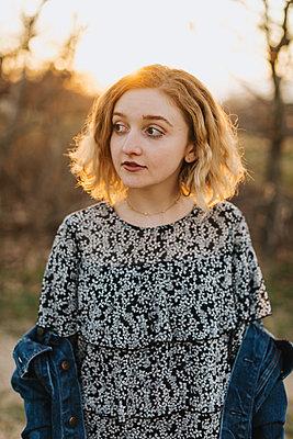 Blond haired young woman looking sideways, Menemsha, Martha's Vineyard, Massachusetts, USA - p924m2058128 by Lena Mirisola