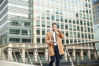 UK, London, Man walking on footbridge - p924m2271239 by Peter Muller