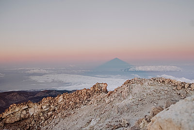 Shadow of Mount Teide in the horizon seen from the summit - p1166m2124346 by Cavan Images