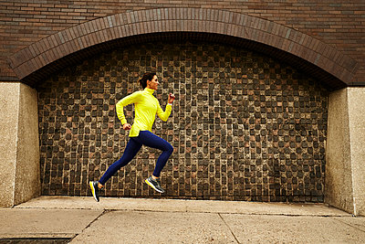 A woman running in Boston - p1166m2212039 by Josh Campbell