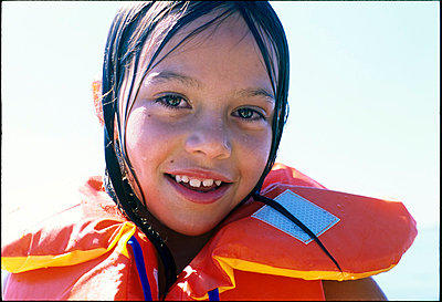 Girl with life vest - p885m858509 by Oliver Brenneisen