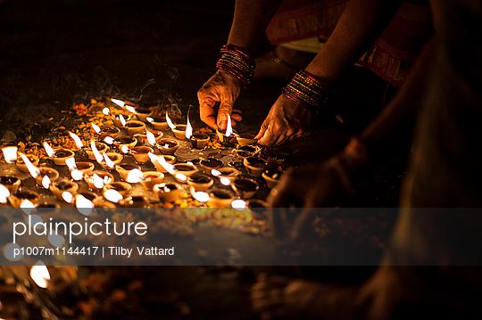 Candle light around Diwali rangoli - p1007m1144417 by Tilby Vattard