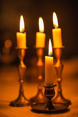 Four candles in candlestick holders - p1418m1572376 by Jan Håkan Dahlström