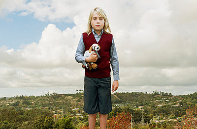 Young Boy with Long Blonde Hair Holding Stuffed Dog - p694m1014843 by Kristianne Riddle