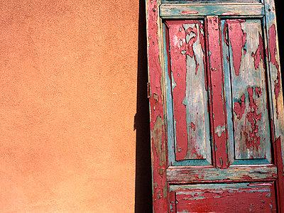 Sunburnt Wooden Door Against Adobe Wall Santa Fe Santa Fe County New Mexico USA - p1072m830246 by Scott Wishart