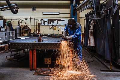 Welder welding metal in a factory - p300m2197605 by Daniel Ingold