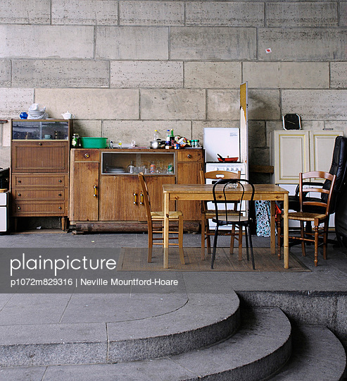Old furniture left under a bridge on the pavement - p1072m829316 by Neville Mountford-Hoare
