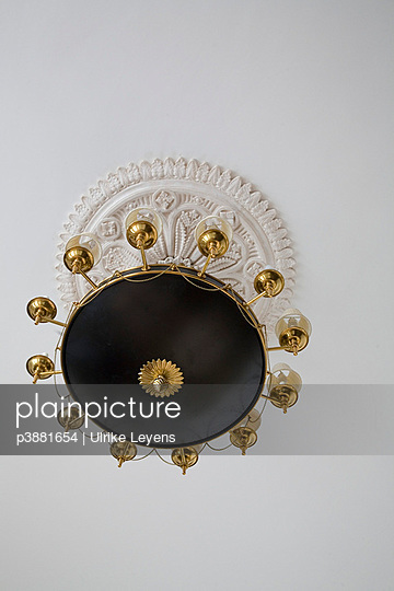 Golden lampshade on ceiling - p3881654 by Ulrike Leyens