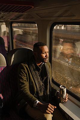 Stylish man traveling by train - p300m2154586 by Hernandez and Sorokina