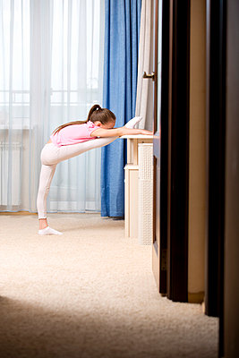 Girl practicing ballet in her room - p301m799519f by Vladimir Godnik