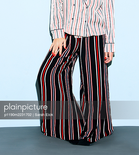 Woman in bellbottoms  - p1190m2231702 by Sarah Eick