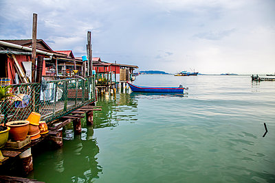 Boat docked along boathouses - p555m1419520 by Inti St Clair