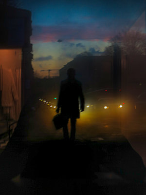 Silhouette Of A Person In A Dark Coat And Briefcase Walking In The Dark Along A Street  - p847m1443756 by Johan Strindberg