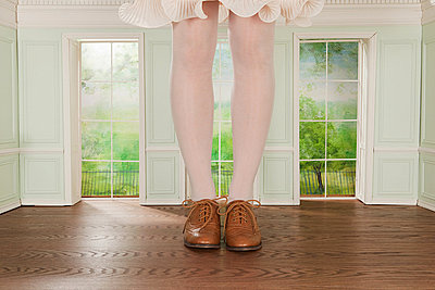 Legs of giant woman in tiny room - p9245566f by Image Source