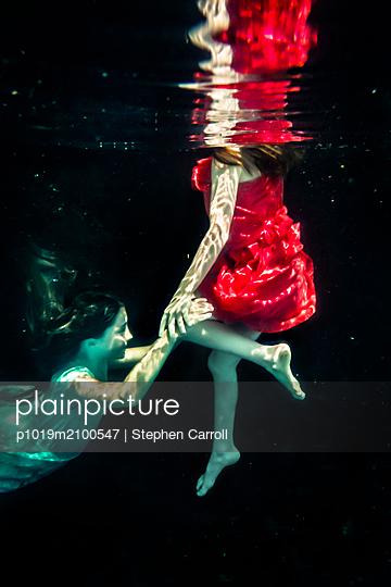 Sisters Underwater  - p1019m2100547 by Stephen Carroll