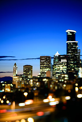 View of Downtown Seattle Skyline with Freeway Traffic at Night - p1166m2261584 by Cavan Images