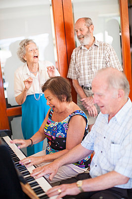 Senior people making music in a retirement village - p300m979139f by zerocreatives