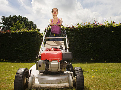 Women with push lawnmower - p4293037f by karan kapoor