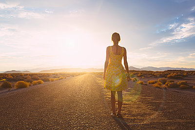 Hispanic woman standing on remote road - p555m1306320 by Dave and Les Jacobs
