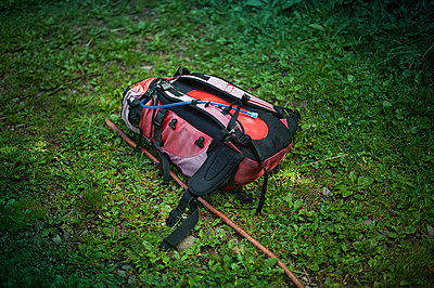 Backpack and wood-stick on the grass - p1007m854287 by Tilby Vattard