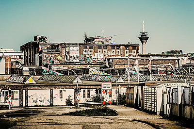Germany, Duesseldorf, industrial area with television tower in the background - p300m1140449 by Frank Röder
